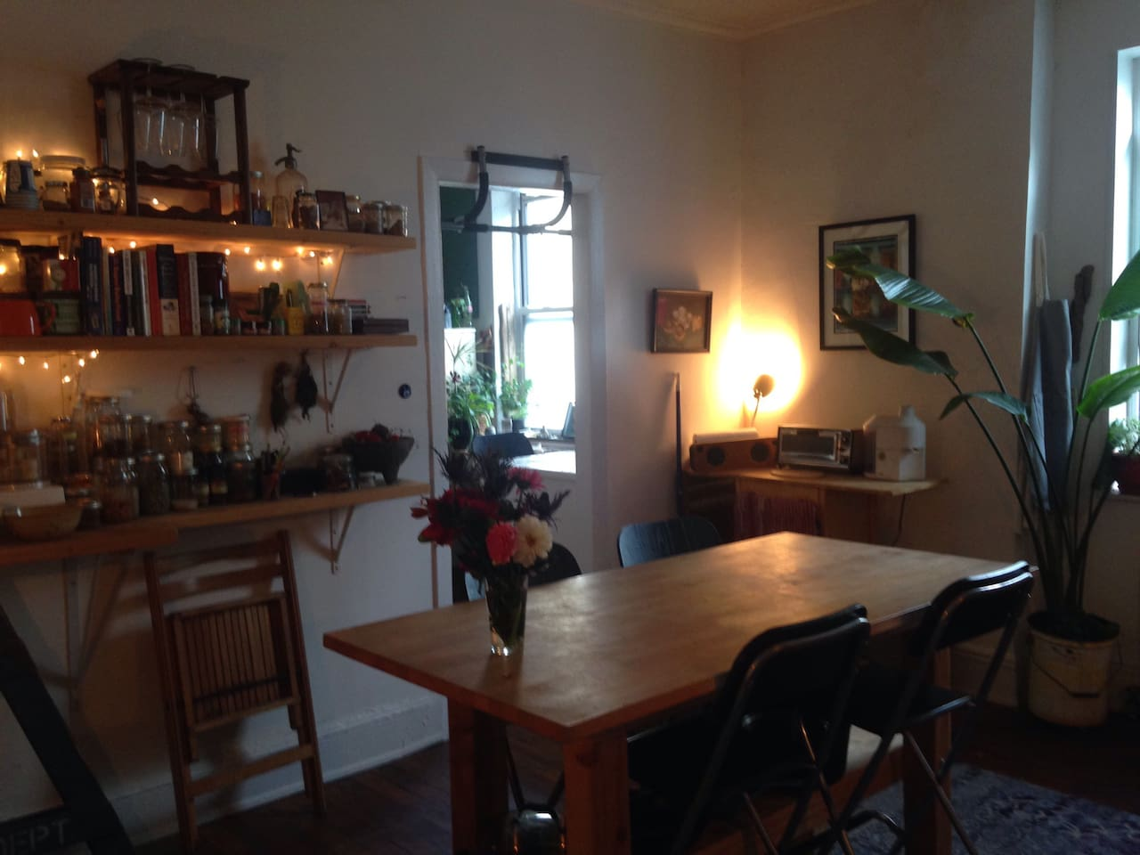 Kitchen table, looking into living room/studio