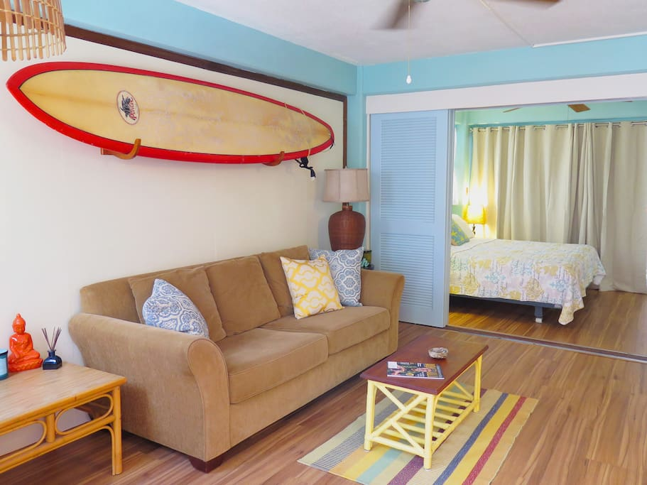 Living room with view to bedroom, surfboard is available for your use! Sofa pulls out to sleep 2