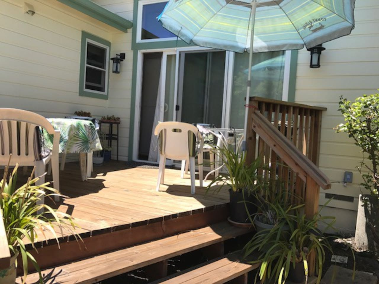 Garden deck welcomes you for your morning coffee, sipping a glass of wine, or a quiet read.