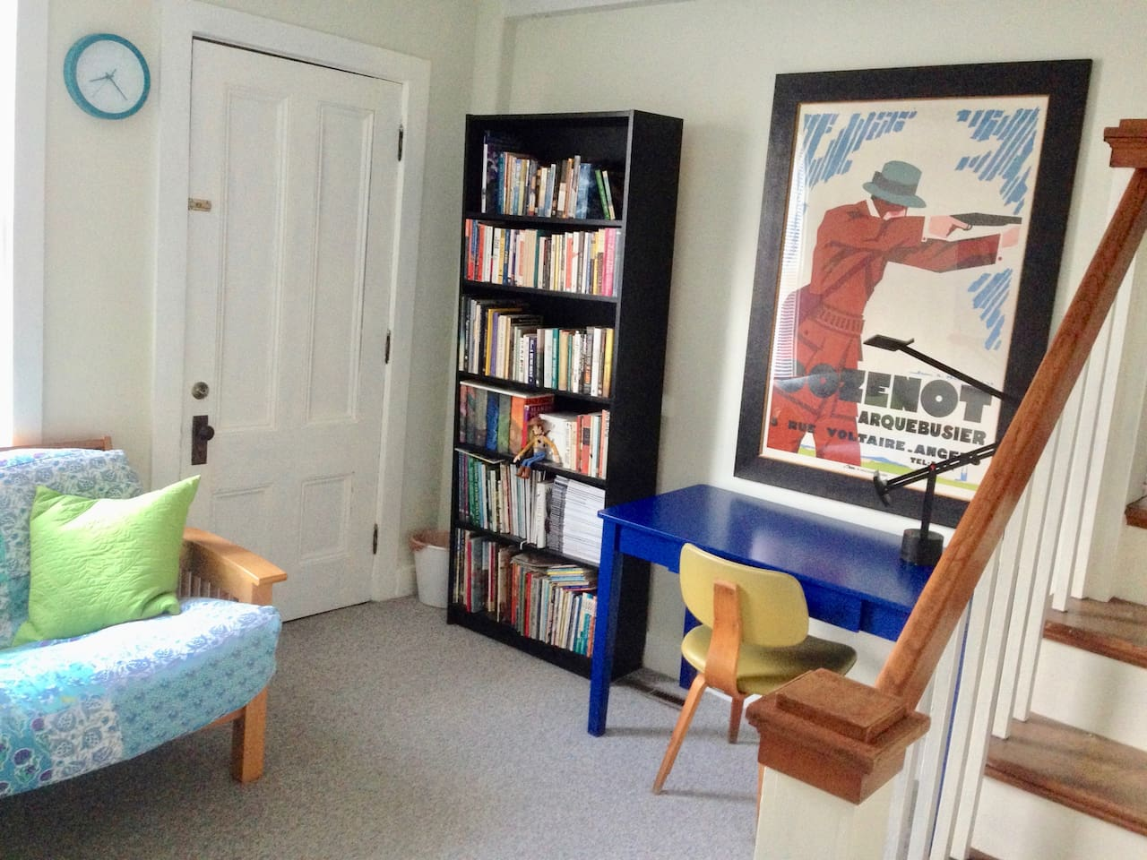 Apartment enters onto a comfy, art-filled workspace and supply of useful novels. Also the futon.