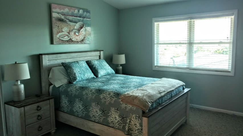 3rd-floor bedroom with ensuite bath and office space. Views of Morehead harbor.