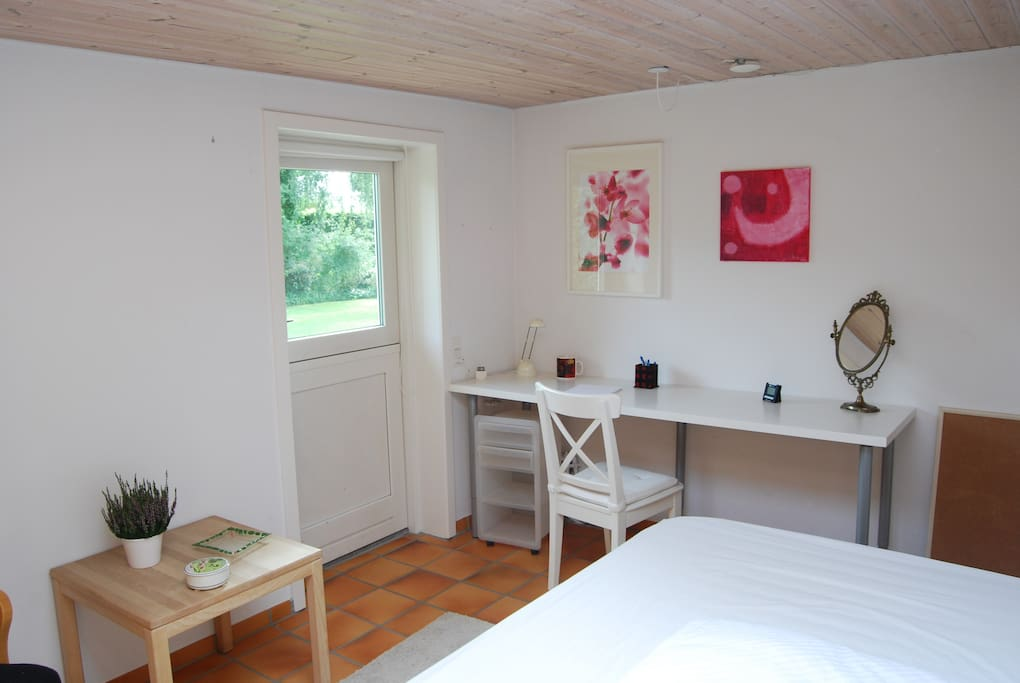 The bedroom has a large working space and is very light!