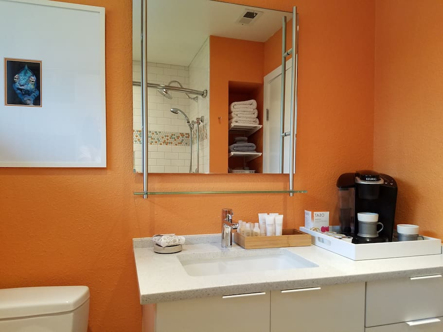 Sparkling clean modern bathroom complete with custom shower, tub & morning coffee & tea.