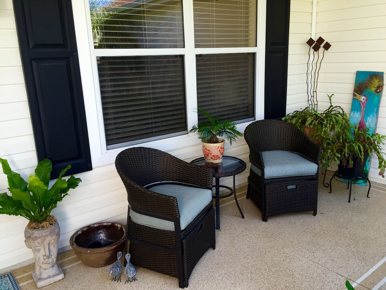Cozy front porch to relax with a cup of coffee and the Daily Sun newspaper.