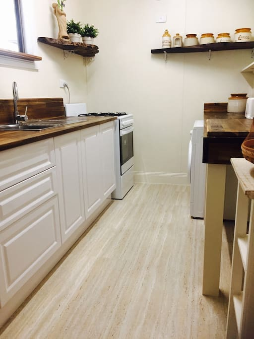 Your full kitchen and laundry facility.