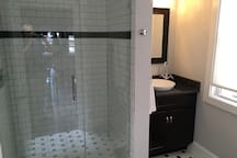 You'll love our walk-in subway tiled rain shower!