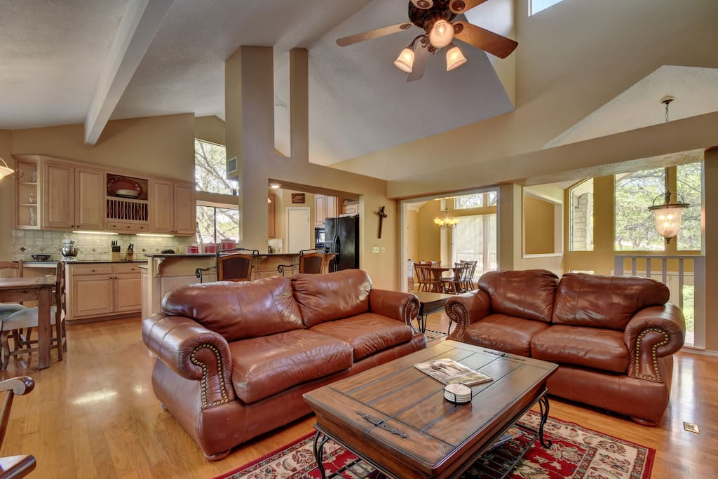 Vaulted ceilings feature throughout this open-concept living, dining, kitchen space.