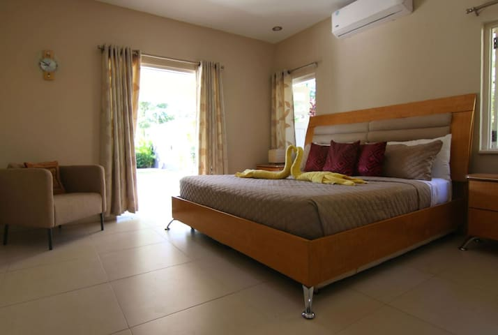 Master Suite  - This suite has one king sized bed, en suite bathroom, walk in closet and direct access to the pool area