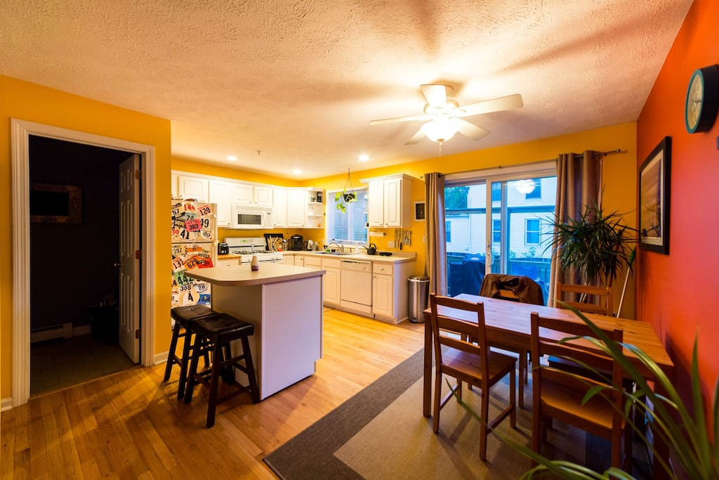 Kitchen and half bath with small back deck for grilling and relaxing outside