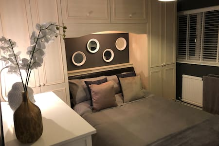 A spotless & stylish bedroom in a beautiful home