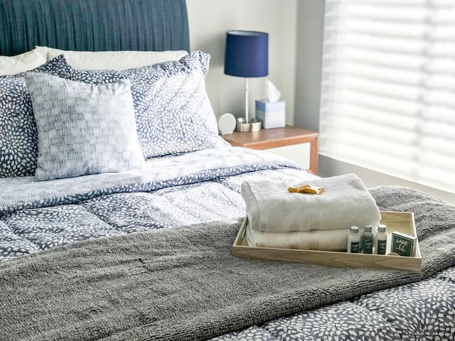 Our inviting guest bedroom includes a comfy queen size bed as well as dresser and television with access to Hulu Live.