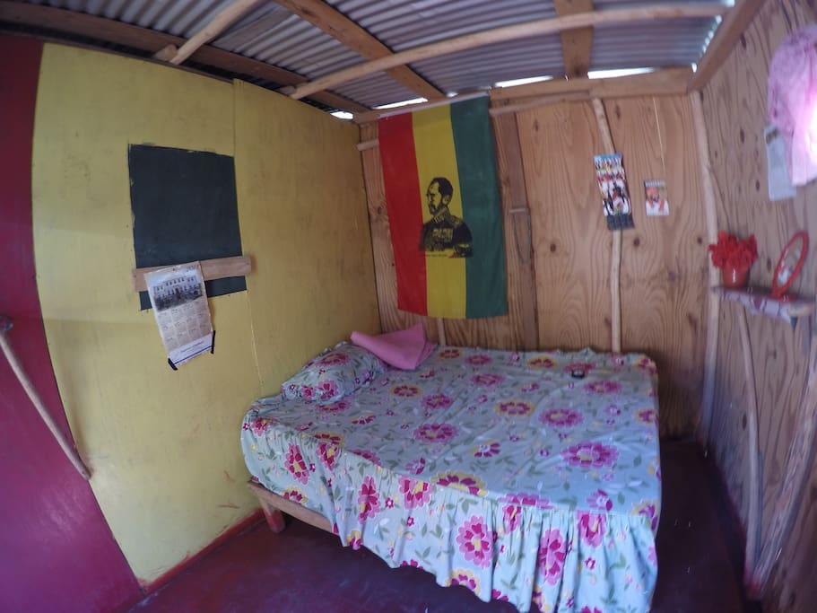double bed inside hut