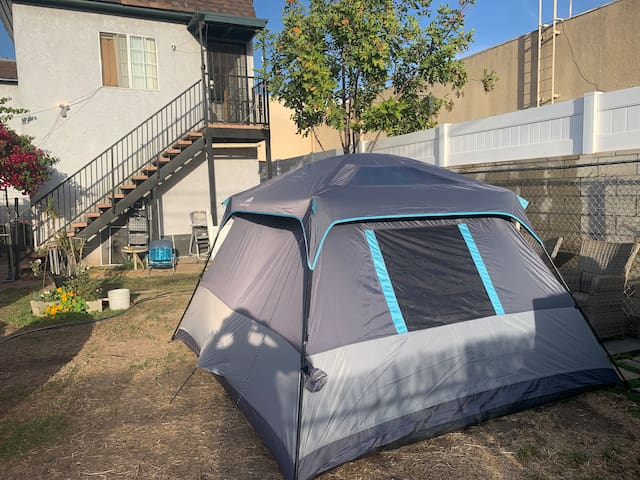 Tent in yard at Anaheim St and Alamitos Ave.