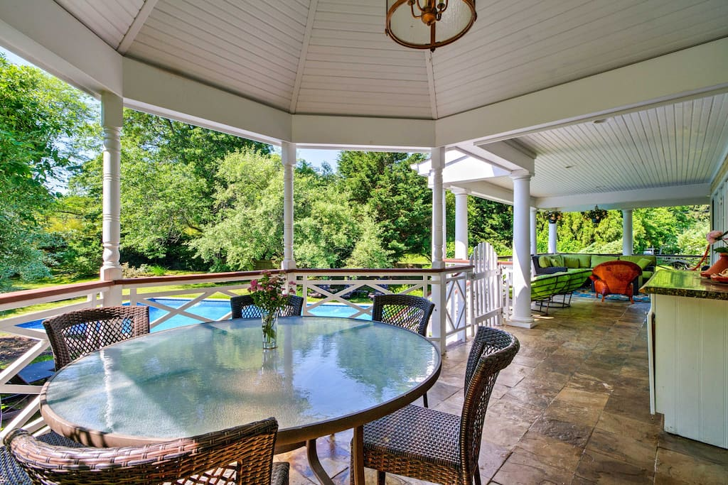 Enjoy breakfast overlooking the pool on the covered upper deck.