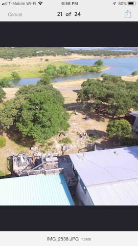 The drone is over our house and that is Canyon Lake you see in the picture.  The water view is fantastic from our decks on both levels and especially from a shaded area close to the water where there is seating and swings for the kids.  Check it out!