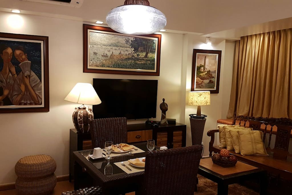 """Dining table for 4, LED HD 54"""" TV with HD cable subscriptions, console table, and antique sofa."""