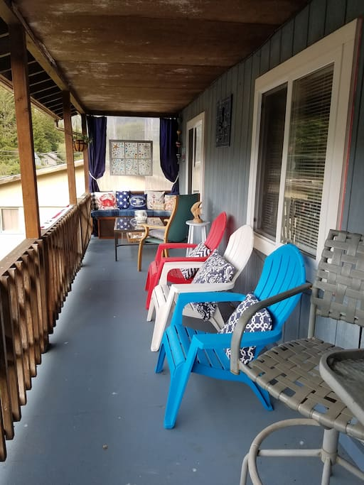 The huge covered porch overlooks the salmon ladder.  Enjoy your coffee, guests, or just read.  Blankets are provided.