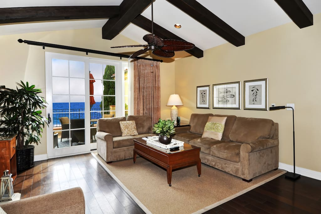 Great room seating adjacent to spacious open air deck. Sofa is a pull out sleeper.