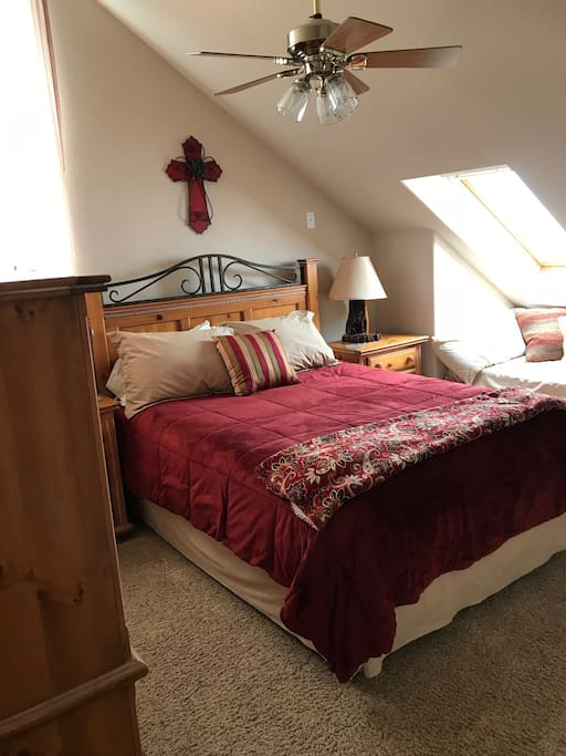 "The ""Red Room"" has a queen bed plus a window seat that can be used as an extra bed."