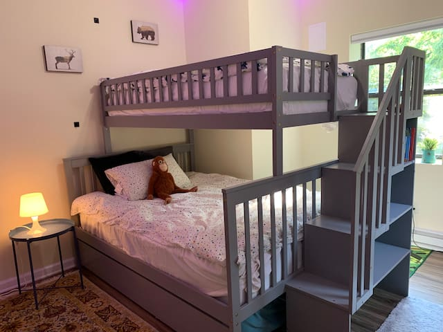 Twin over full, with a twin trundle- can accommodate 4 guests.