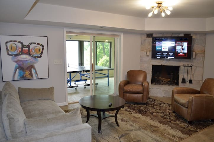 Terrace level family room with comfy couch, smart TV, and Murphy bed