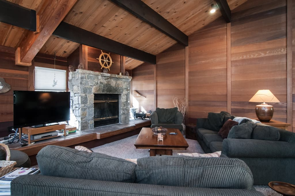 great room with beamed ceiling and big wood burning fireplace