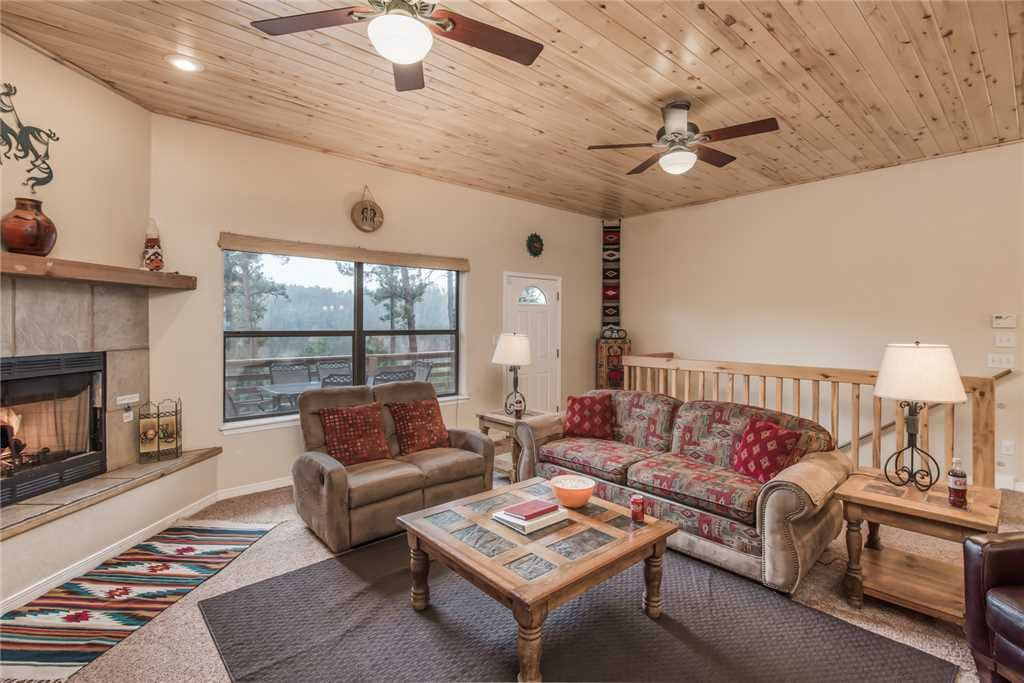 Spacious Living Room - Alto Family Escape has large, comfortable couches, cable TV, and ceiling fan so you can enjoy your evenings with family and lots of breathing room.