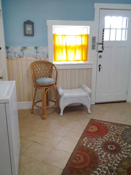 The back entry hall houses the washer and dryer and is a great place to put your belongings after a long day at the beach.