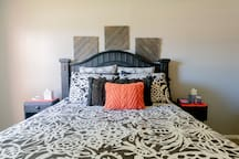 Queen bed in bedroom with all linens provided