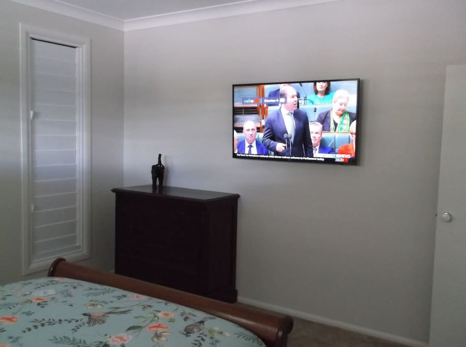 Bedroom with flat screen TV