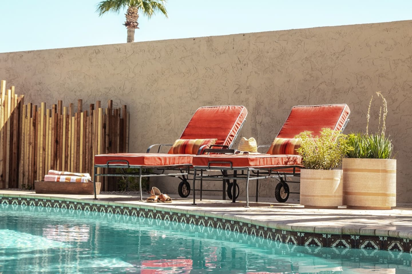 Comfy loungers and chairs throughout the patio and around the pool make for perfect sunbathing perches.