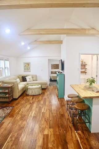 Get cozy on the couch or pull up a stool and hang out around the island in your open space or hideaway in one of the comfortable bedrooms beyond.  (If you are viewing this with a mobile device, click on picture to get a more expansive view of space.)