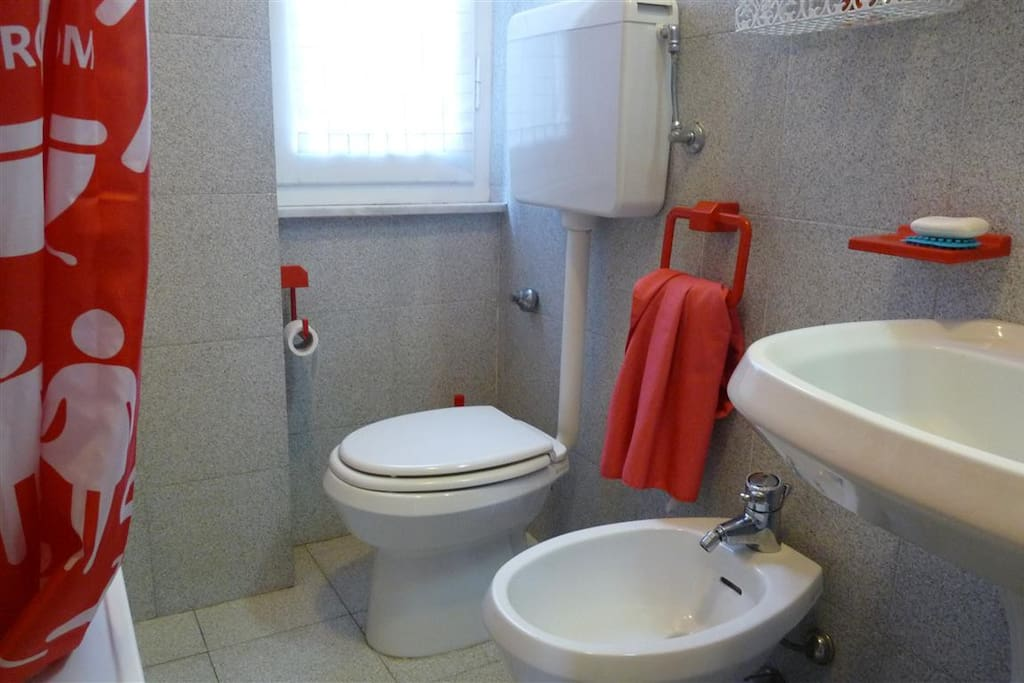 Bathroom with small bath tub shower over and ful suite.