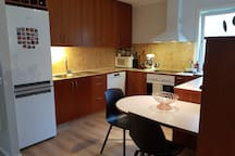 Well equipped kitchen includes a stove, oven, microwave, toaster, coffee maker, dish washer, and more.