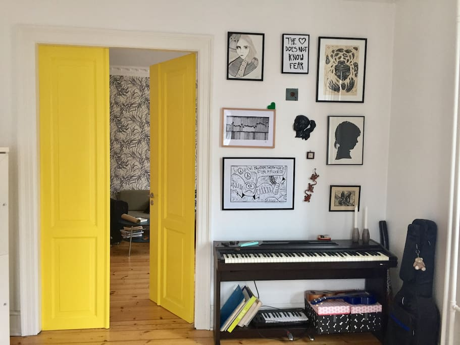 This is my Creative & Music room. This is also the private room that I am renting out occasionally. The room is spacious and minimalistic decorated and has a door that leads to the hallway and a door that leads into the living room (the yellow door). Additionally, the room has a small balcony where you can do your morning stretch.