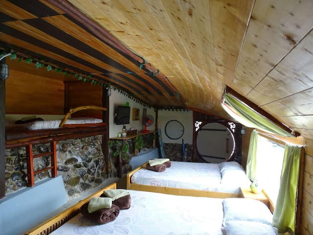 Two queen beds, and a cosy single bed in the wall.