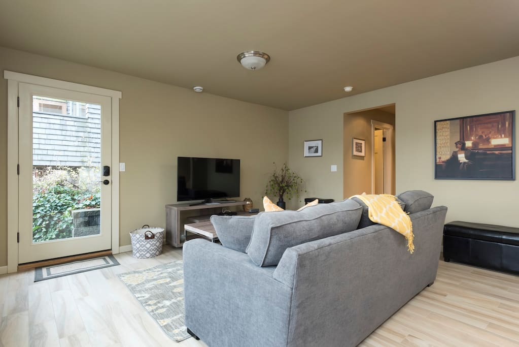 Living area showing entrance and foldout couch