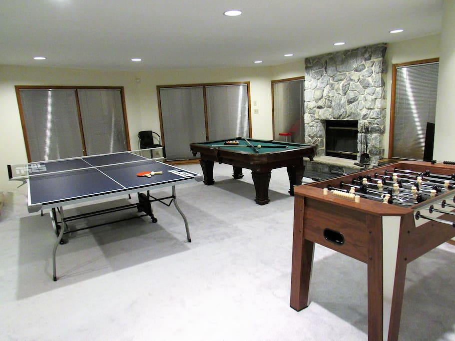 Huge game room! Full size ping pong table, pool table, Fooseball and a second kitchen with a refrigerator.