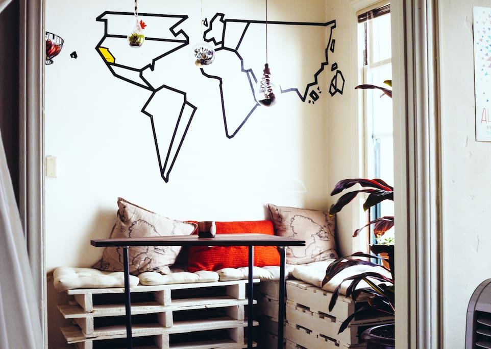 Charming DIY pallet breakfast nook with abstract map of the world