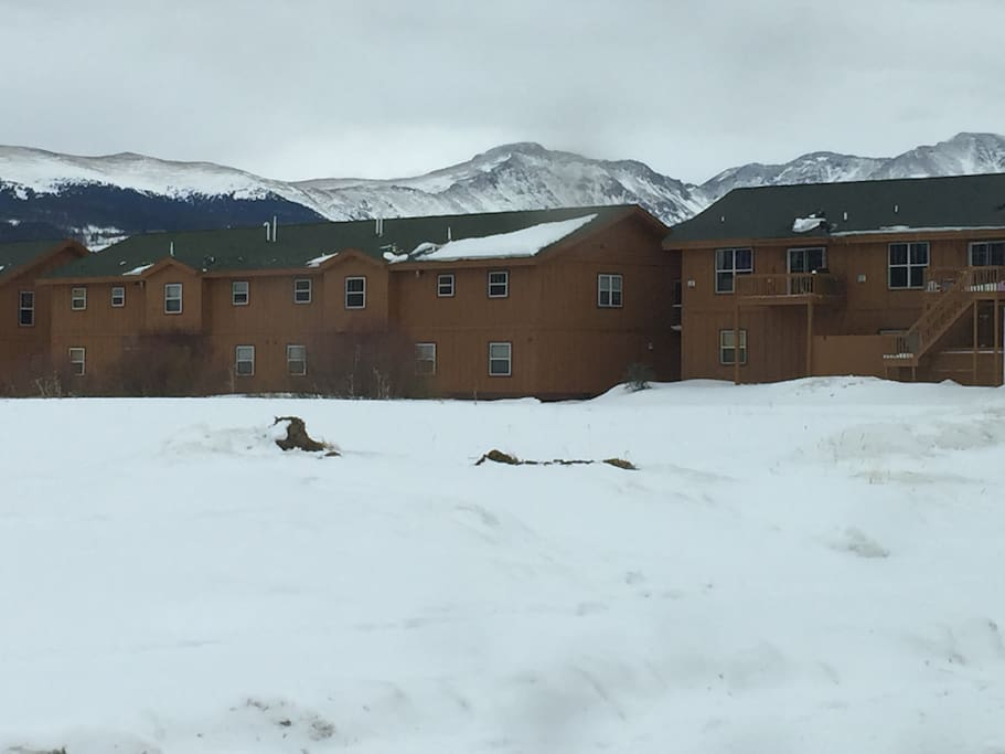 View of the back of our complex, adjacent to open space, with Continental Divide to the Southeast
