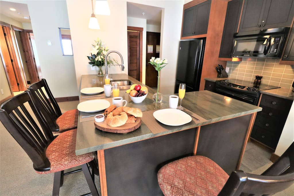 The kitchen island is a great spot to have breakfast before enjoying any activities