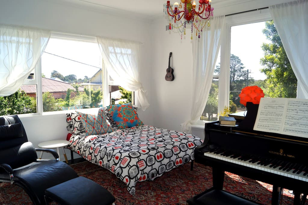 Airy front room with double bed, 2 built in heaters and piano