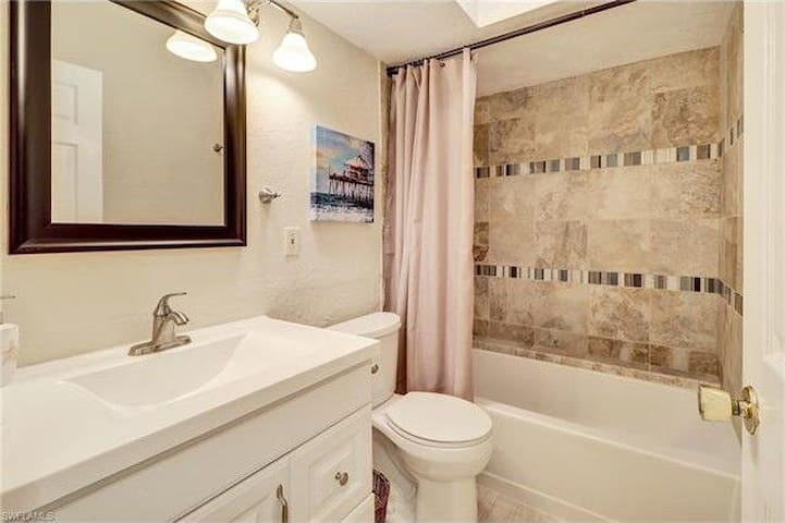 Your private bathroom and shower completely stocked with toiletries.