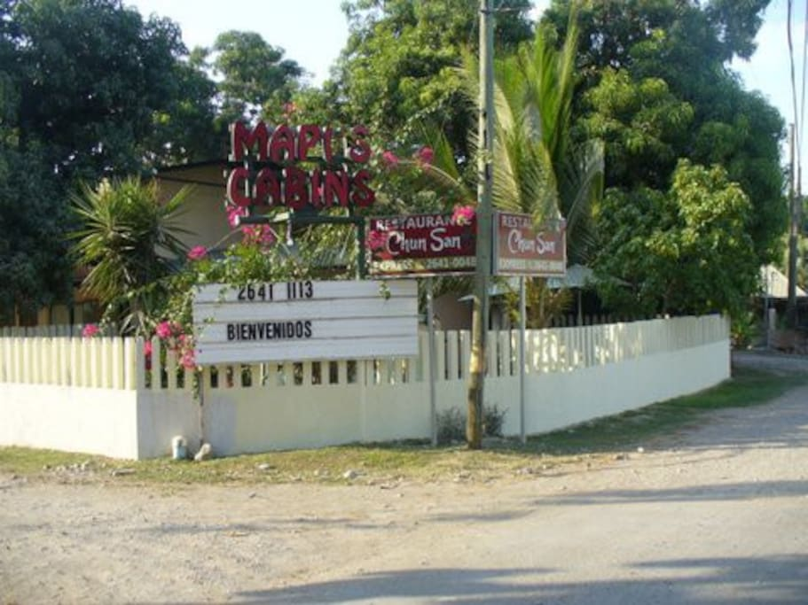 FRONTAGE SIGNAGE OF MAPI'S with Fence surrounding Pool