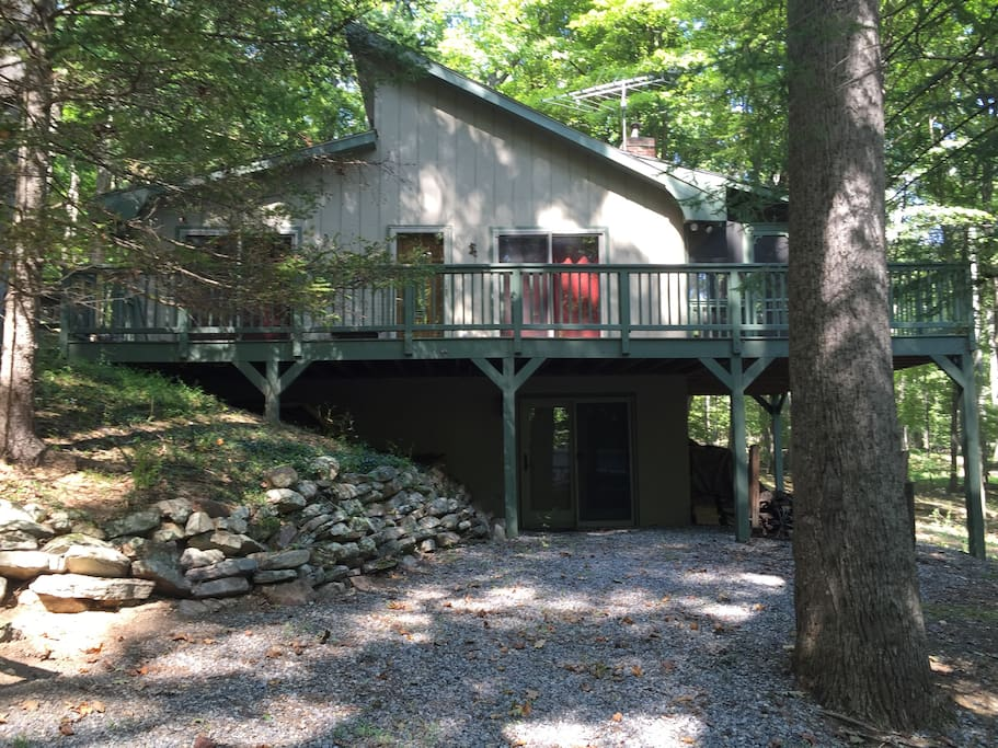 Two story home set in the woods with screened porch for relaxing and watching wildlife.