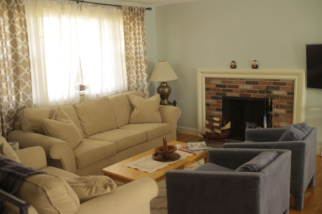"Living room - furnished with comfortable sofa's and a 50"" flat screen smart  TV."