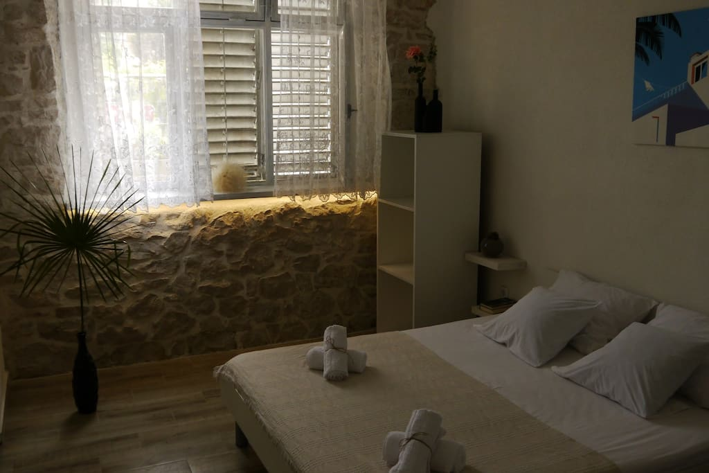 Another look at our clean, sleek and modern room featuring the stone wall.