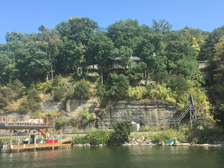 View from the lake. 100 steps down to the dock. Note* House is elevated on cliff.