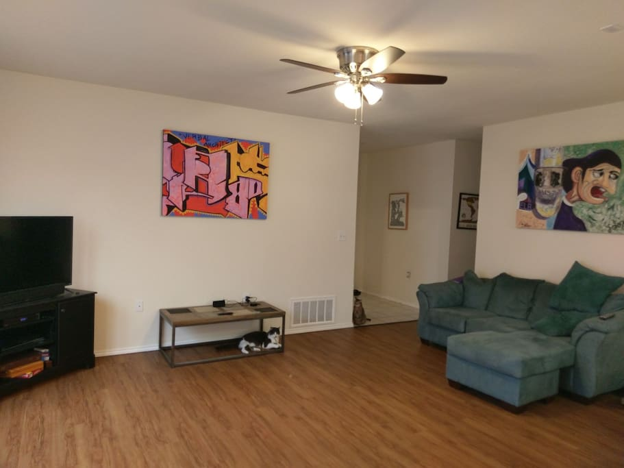 Spacious living room for relaxation and watching television. Premium digital cable service.
