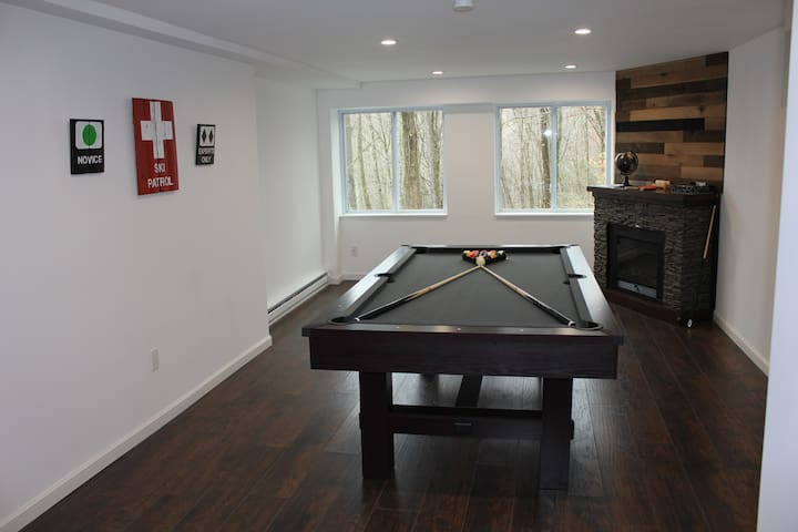 Pool table with 2 full size cue's and a mini cue for those tight shots.